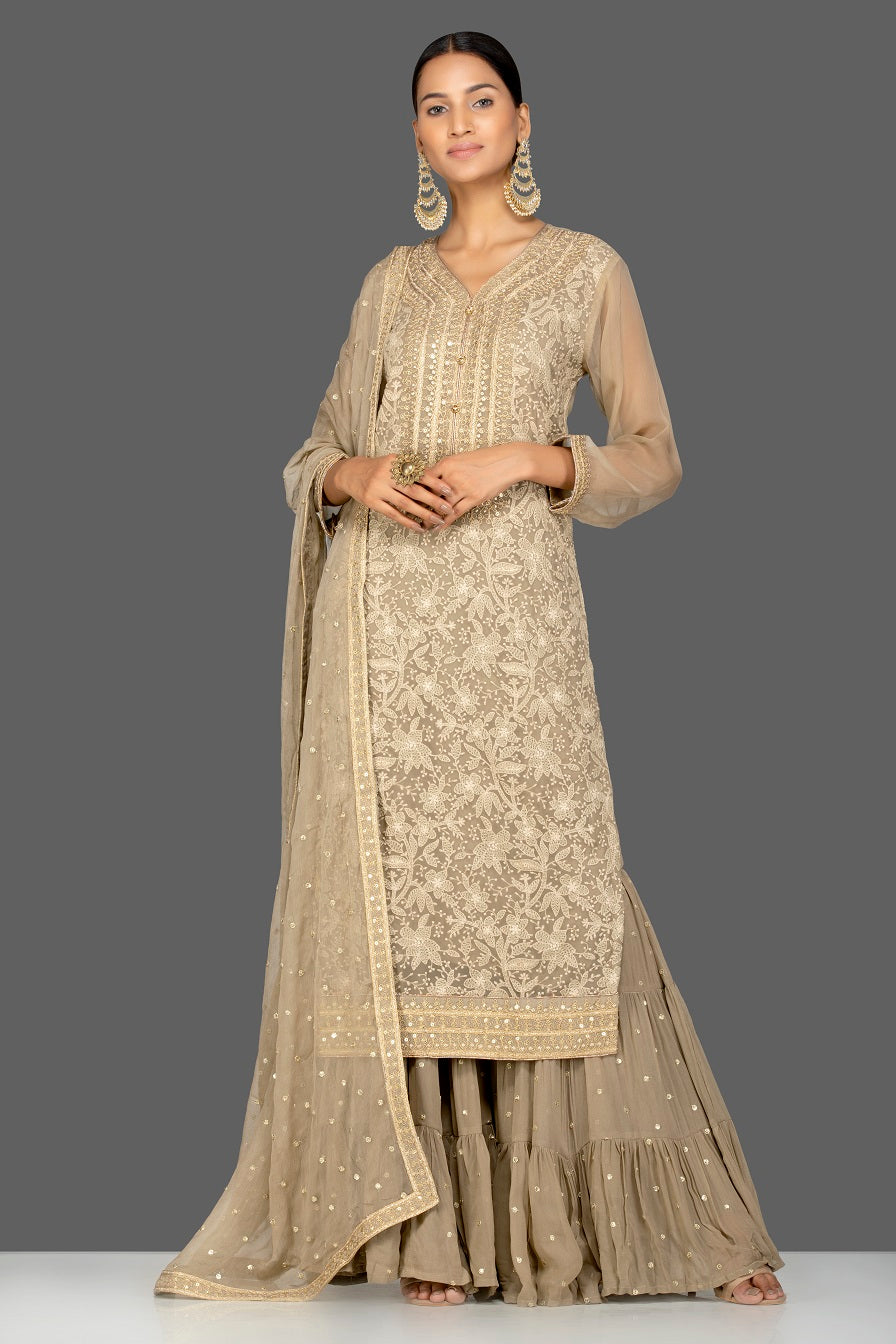Shop gorgeous beige embroidered georgette sharara suit online in USA with dupatta. Be an epitome of Indian fashion with a premium range of designer suits, Anarkali dresses from Pure Elegance luxury Indian fashion store in USA. Buy online now.-front
