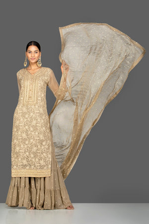 Shop gorgeous beige embroidered georgette sharara suit online in USA with dupatta. Be an epitome of Indian fashion with a premium range of designer suits, Anarkali dresses from Pure Elegance luxury Indian fashion store in USA. Buy online now.-full view