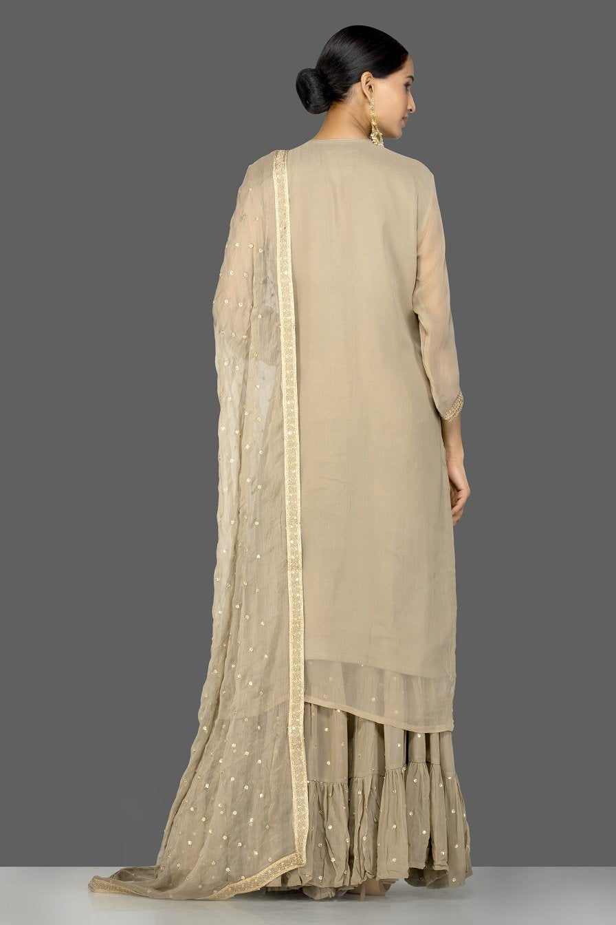 Shop gorgeous beige embroidered georgette sharara suit online in USA with dupatta. Be an epitome of Indian fashion with a premium range of designer suits, Anarkali dresses from Pure Elegance luxury Indian fashion store in USA. Buy online now.-pleats