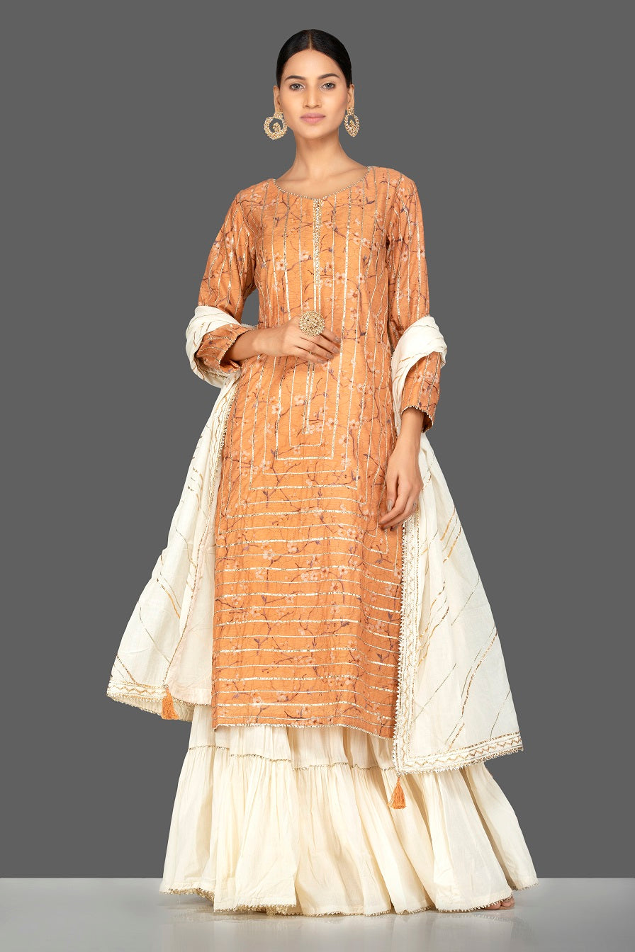 Shop beautiful orange and cream gota work chanderi cotton suit online in USA with dupatta. Be an epitome of Indian fashion with a premium range of designer suits, Anarkali dresses from Pure Elegance luxury Indian fashion store in USA. Buy online now.-full view