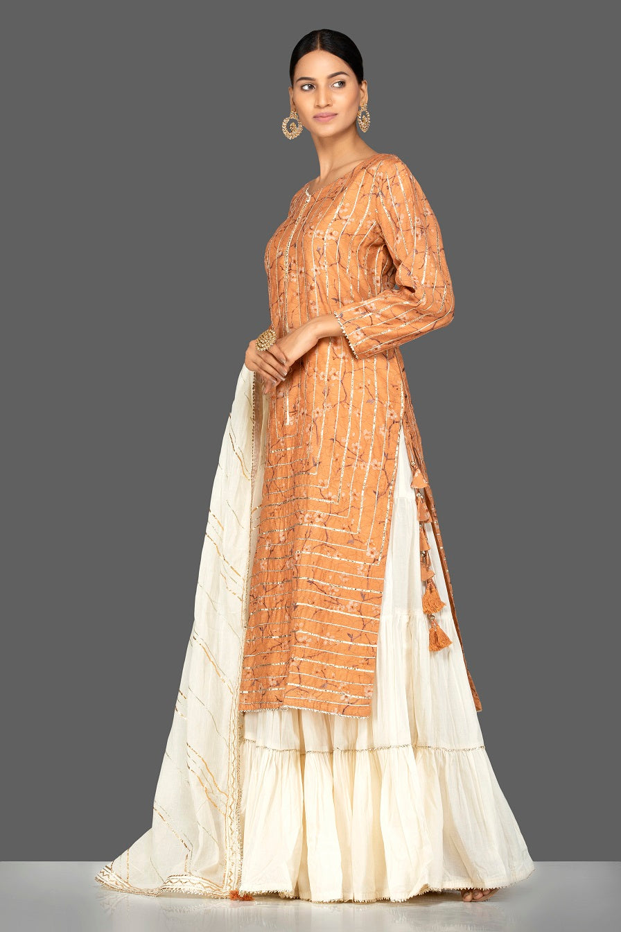 Shop beautiful orange and cream gota work chanderi cotton suit online in USA with dupatta. Be an epitome of Indian fashion with a premium range of designer suits, Anarkali dresses from Pure Elegance luxury Indian fashion store in USA. Buy online now.-side