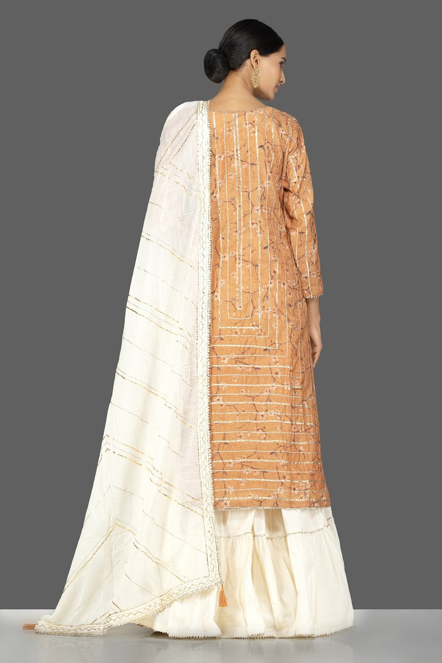 Shop beautiful orange and cream gota work chanderi cotton suit online in USA with dupatta. Be an epitome of Indian fashion with a premium range of designer suits, Anarkali dresses from Pure Elegance luxury Indian fashion store in USA. Buy online now.-back