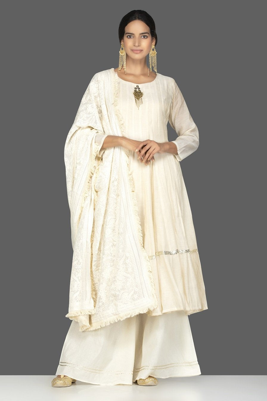 Shop elegant cream tissue chanderi palazzo suit online in USA with dupatta. Be an epitome of Indian fashion with a premium range of designer suits, Anarkali dresses from Pure Elegance luxury Indian fashion store in USA. Buy online now.-full view