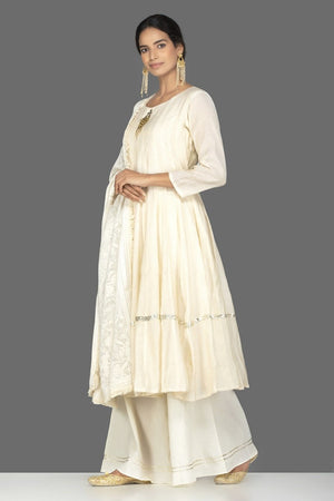 Shop elegant cream tissue chanderi palazzo suit online in USA with dupatta. Be an epitome of Indian fashion with a premium range of designer suits, Anarkali dresses from Pure Elegance luxury Indian fashion store in USA. Buy online now.-side