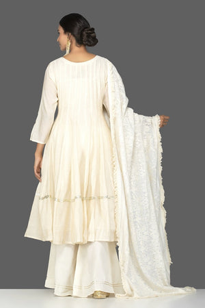 Shop elegant cream tissue chanderi palazzo suit online in USA with dupatta. Be an epitome of Indian fashion with a premium range of designer suits, Anarkali dresses from Pure Elegance luxury Indian fashion store in USA. Buy online now.-back