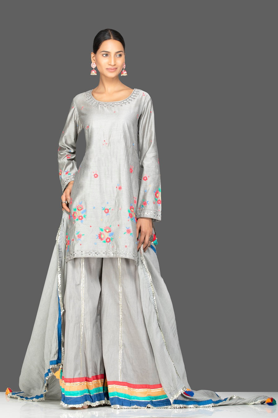 Shop gorgeous steel grey embroidered chanderi silk sharara suit online in USA with dupatta. Be an epitome of Indian fashion with a premium range of designer suits, Anarkali dresses from Pure Elegance luxury Indian fashion store in USA. Buy online now.-full view
