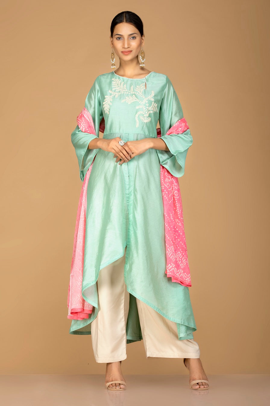Buy elegant mint green and cream chanderi silk palazzo suit online in USA with pink dupatta. Be an epitome of Indian fashion with a premium range of designer suits, Anarkali dresses from Pure Elegance luxury Indian fashion store in USA. Buy online now.-full view