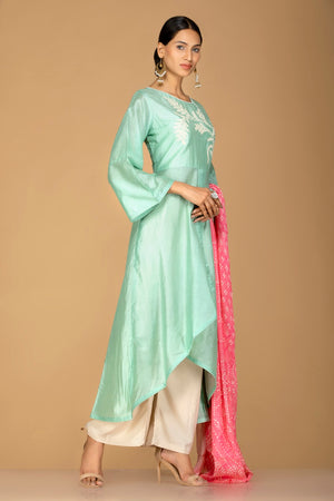 Buy elegant mint green and cream chanderi silk palazzo suit online in USA with pink dupatta. Be an epitome of Indian fashion with a premium range of designer suits, Anarkali dresses from Pure Elegance luxury Indian fashion store in USA. Buy online now.-side