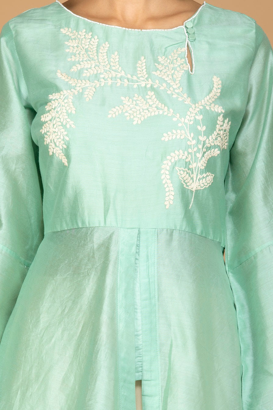 Buy elegant mint green and cream chanderi silk palazzo suit online in USA with pink dupatta. Be an epitome of Indian fashion with a premium range of designer suits, Anarkali dresses from Pure Elegance luxury Indian fashion store in USA. Buy online now.-closeup