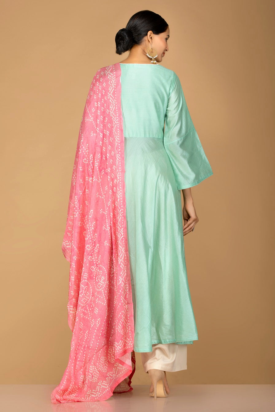 Buy elegant mint green and cream chanderi silk palazzo suit online in USA with pink dupatta. Be an epitome of Indian fashion with a premium range of designer suits, Anarkali dresses from Pure Elegance luxury Indian fashion store in USA. Buy online now.-back