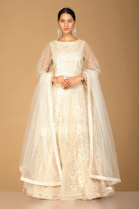 Buy lovely cream stone and thread work net Anarkali online in USA with dupatta. Go for an extraordinary traditional look with splendid designer Anarkali suits. salwar suits from Pure Elegance from Indian boutique in USA.  Shop online or visit our store now.-full view