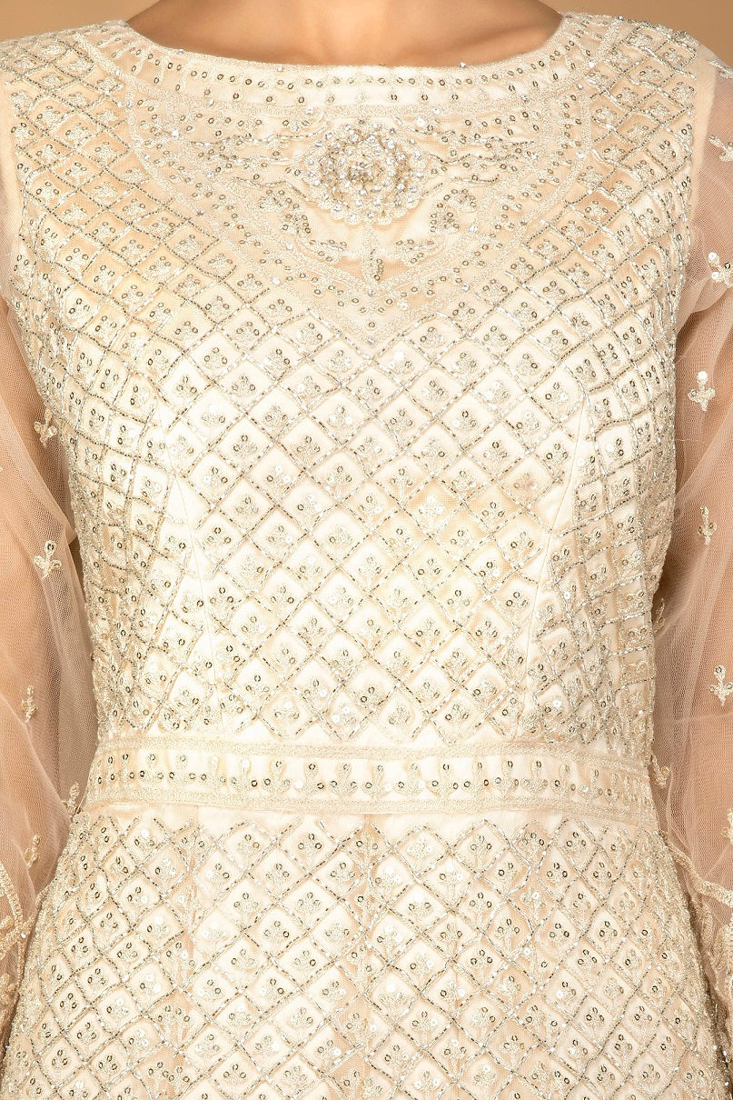 Buy lovely cream stone and thread work net Anarkali online in USA with dupatta. Go for an extraordinary traditional look with splendid designer Anarkali suits. salwar suits from Pure Elegance from Indian boutique in USA.  Shop online or visit our store now.-closeup