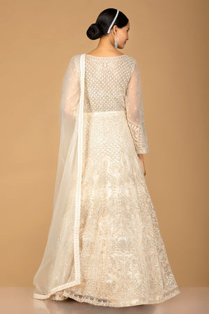 Buy lovely cream stone and thread work net Anarkali online in USA with dupatta. Go for an extraordinary traditional look with splendid designer Anarkali suits. salwar suits from Pure Elegance from Indian boutique in USA.  Shop online or visit our store now.-back