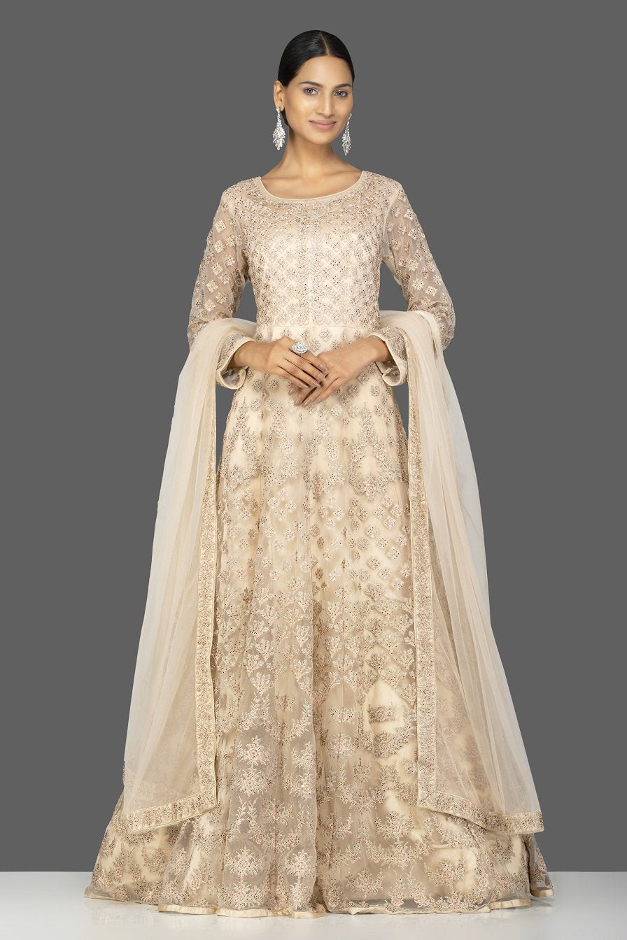 Shop ravishing cream stone and thread embroidery net Anarkali online in USA with dupatta. Go for an extraordinary traditional look with splendid designer Anarkali suits. salwar suits from Pure Elegance from Indian boutique in USA.  Shop online or visit our store now.-full view