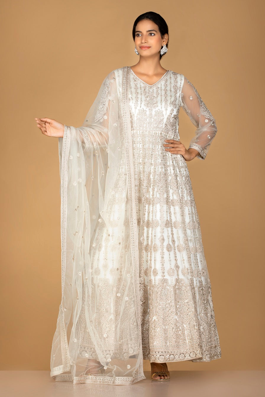 Buy charming off-white embroidered net Anarkali suit online in USA with dupatta. Go for an extraordinary traditional look with splendid designer Anarkali suits. salwar suits from Pure Elegance from Indian boutique in USA.  Shop online or visit our store now.-full view