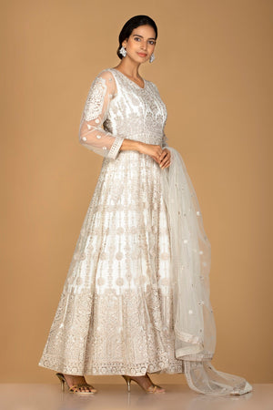 Buy charming off-white embroidered net Anarkali suit online in USA with dupatta. Go for an extraordinary traditional look with splendid designer Anarkali suits. salwar suits from Pure Elegance from Indian boutique in USA.  Shop online or visit our store now.-side
