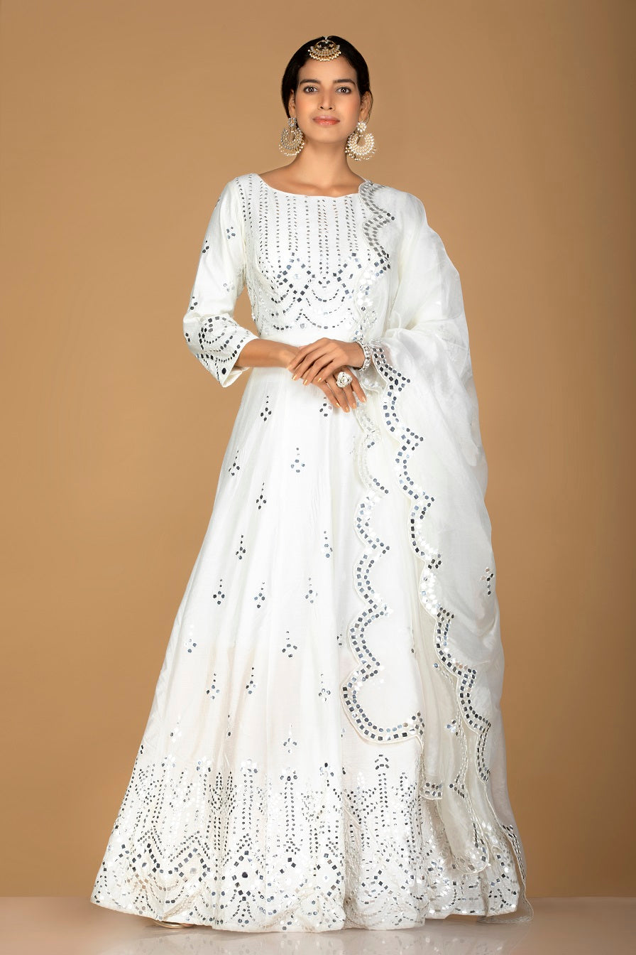 Buy gorgeous white mirror work chanderi silk Anarkali online in USA. Turn heads at weddings and festive occasions with exquiste Indian women designer clothes from Pure Elegance Indian fashion store in USA. Shop now.-full view