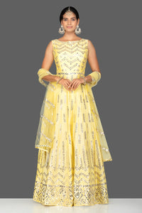 Buy gorgeous yellow mirror work chanderi silk Anarkali suit online in USA with dupatta. Go for an extraordinary traditional look with splendid designer Anarkali suits. salwar suits from Pure Elegance from Indian boutique in USA.  Shop online or visit our store now.-full view