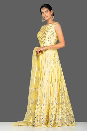 Buy gorgeous yellow mirror work chanderi silk Anarkali suit online in USA with dupatta. Go for an extraordinary traditional look with splendid designer Anarkali suits. salwar suits from Pure Elegance from Indian boutique in USA.  Shop online or visit our store now.-side
