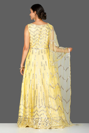 Buy gorgeous yellow mirror work chanderi silk Anarkali suit online in USA with dupatta. Go for an extraordinary traditional look with splendid designer Anarkali suits. salwar suits from Pure Elegance from Indian boutique in USA.  Shop online or visit our store now.-back