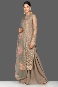 Buy beautiful brown embroidered net sharara suit online in USA with floral organza dupatta. Turn heads at weddings and festive occasions with exquiste Indian women designer clothes from Pure Elegance Indian fashion store in USA. Shop now.-side