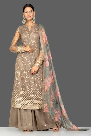 Buy beautiful brown embroidered net sharara suit online in USA with floral organza dupatta. Turn heads at weddings and festive occasions with exquiste Indian women designer clothes from Pure Elegance Indian fashion store in USA. Shop now.-front