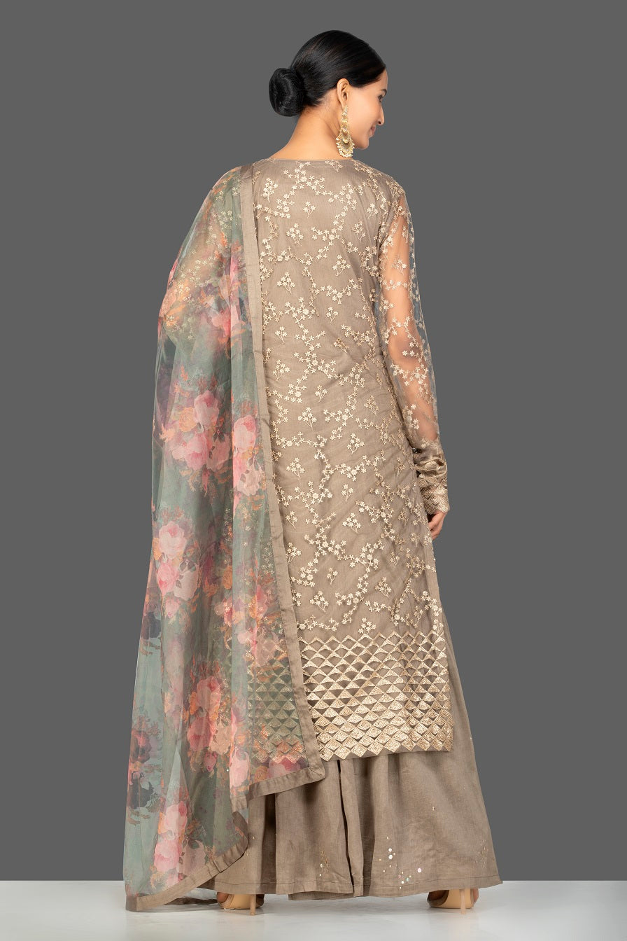 Buy beautiful brown embroidered net sharara suit online in USA with floral organza dupatta. Turn heads at weddings and festive occasions with exquiste Indian women designer clothes from Pure Elegance Indian fashion store in USA. Shop now.-closeup