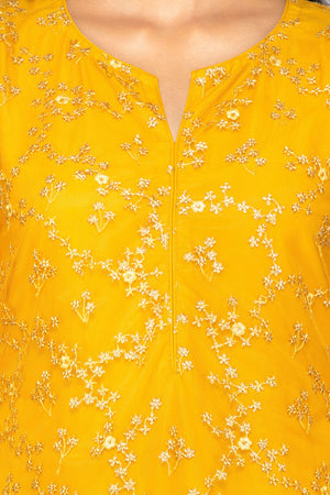 Shop lovely yellow embroidered net sharara suit online in USA with floral organza dupatta. Turn heads at weddings and festive occasions with exquisite Indian women designer clothes from Pure Elegance Indian fashion store in USA. Shop now.-closeup
