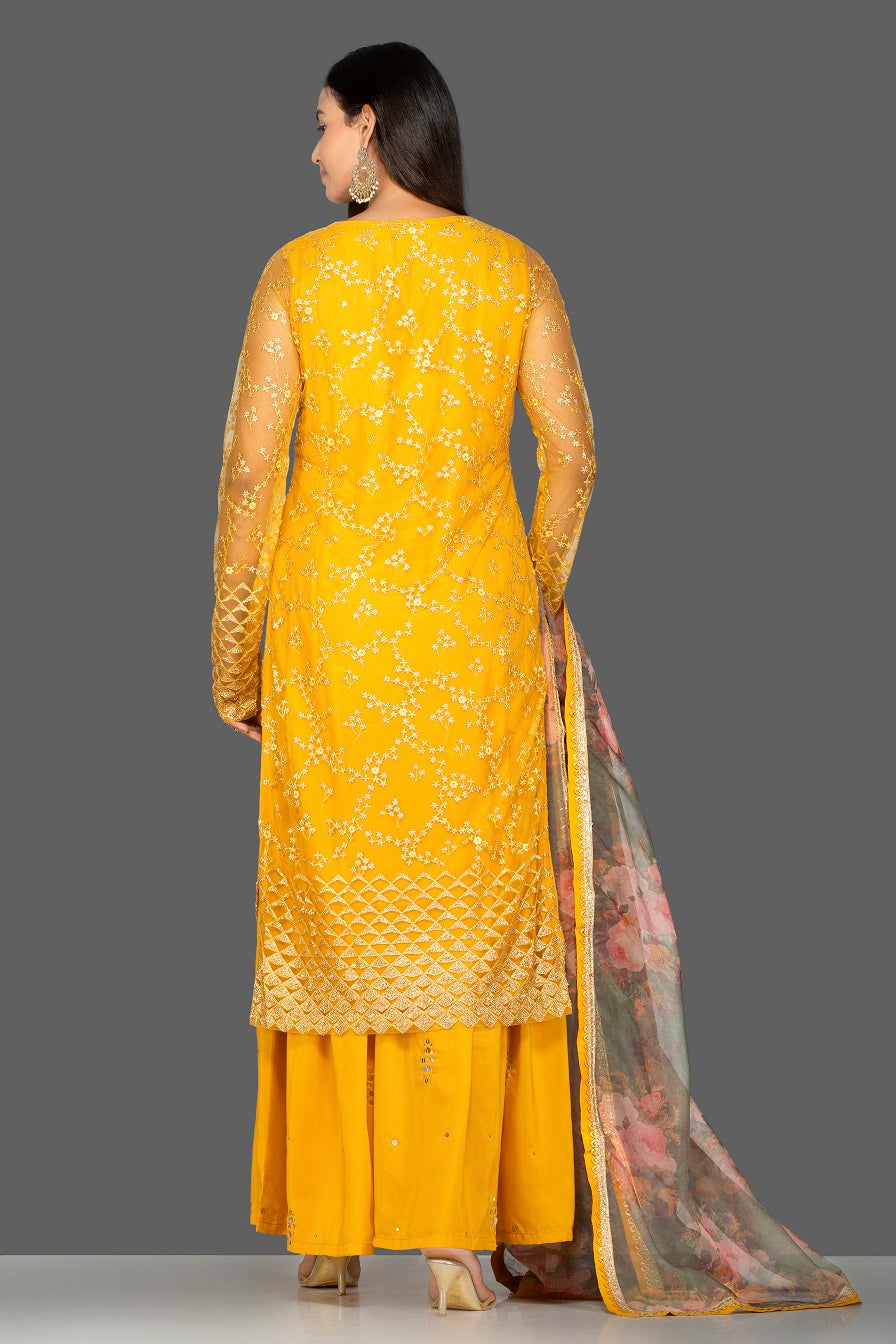 Shop lovely yellow embroidered net sharara suit online in USA with floral organza dupatta. Turn heads at weddings and festive occasions with exquisite Indian women designer clothes from Pure Elegance Indian fashion store in USA. Shop now.-back