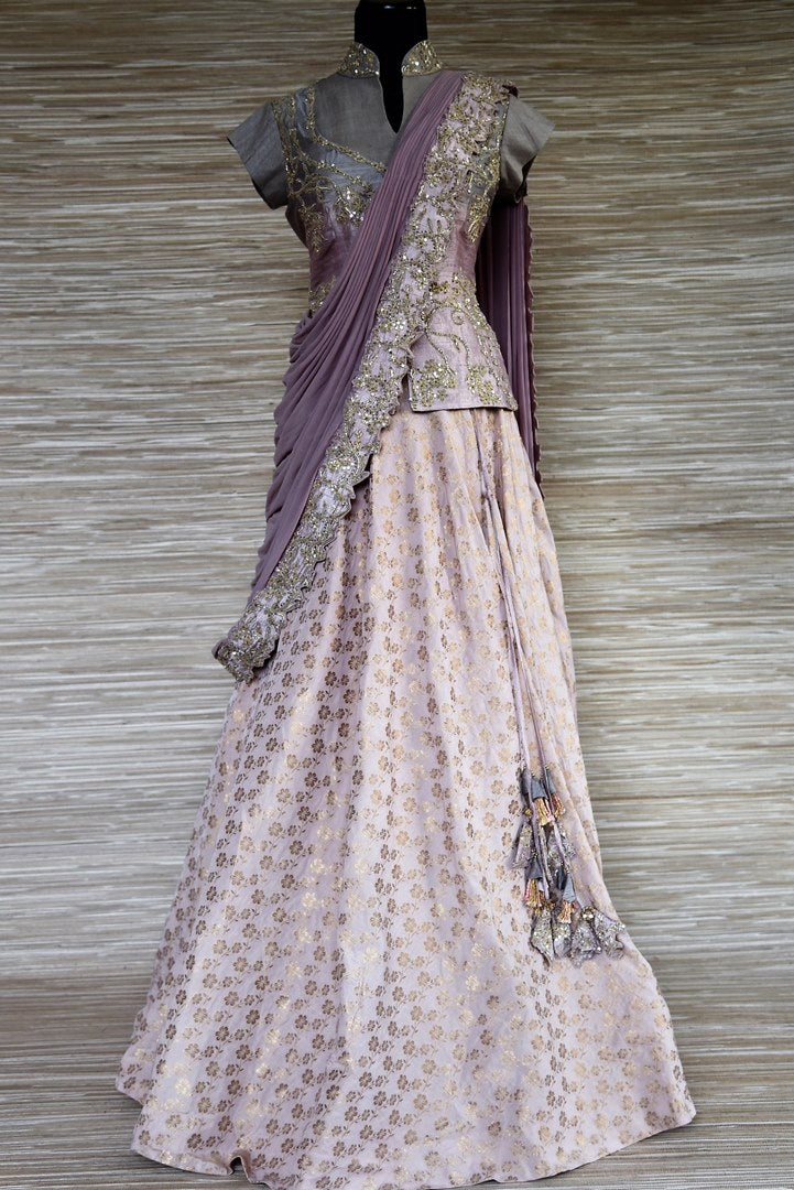 Buy grey and mauve embroidered net and silk lehenga online  in USA. Enhance your traditional style on special occasions with splendid designer lehengas, Indian dresses from Pure Elegance Indian fashion store in USA.-full view
