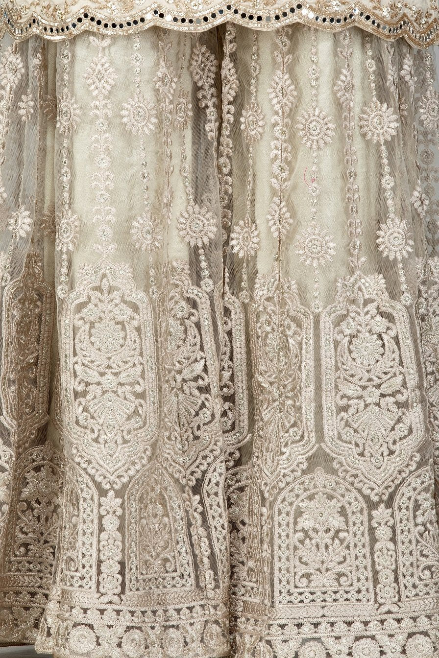 Shop stunning cream silk and net embroidered sharara suit online in USA with matching dupatta. Turn heads at weddings and festive occasions with exquisite Indian women designer clothes from Pure Elegance Indian fashion store in USA. Shop now.-closeup