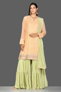 Buy elegant cream and green resham thread embroidery sharara suit online in USA with green dupatta. Turn heads at weddings and festive occasions with exquisite Indian women designer clothes from Pure Elegance Indian fashion store in USA. Shop now.-full view