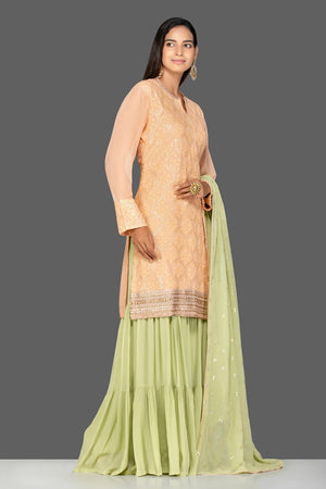 Buy elegant cream and green resham thread embroidery sharara suit online in USA with green dupatta. Turn heads at weddings and festive occasions with exquisite Indian women designer clothes from Pure Elegance Indian fashion store in USA. Shop now.-side