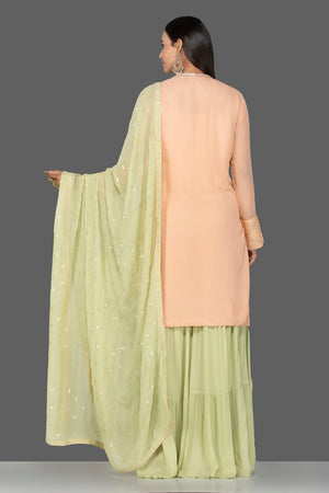 Buy elegant cream and green resham thread embroidery sharara suit online in USA with green dupatta. Turn heads at weddings and festive occasions with exquisite Indian women designer clothes from Pure Elegance Indian fashion store in USA. Shop now.-back