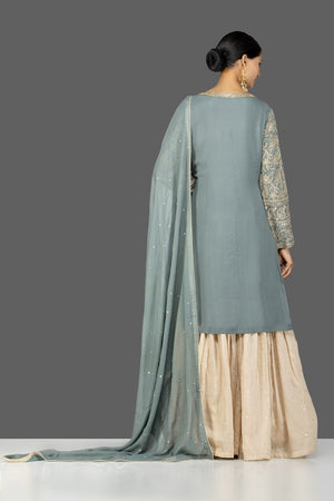 Shop beautiful grey and cream resham thread embroidery palazzo suit online in USA with dupatta. Turn heads at weddings and festive occasions with exquisite Indian women designer clothes from Pure Elegance Indian fashion store in USA. Shop now.-back