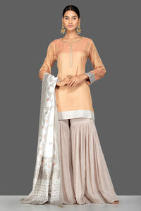 Shop gorgeous golden and grey tissue silk and Banarasi sharara online in USA with matching dupatta. Turn heads at weddings and festive occasions with exquisite Indian women designer clothes from Pure Elegance Indian fashion store in USA. Shop now.-full view