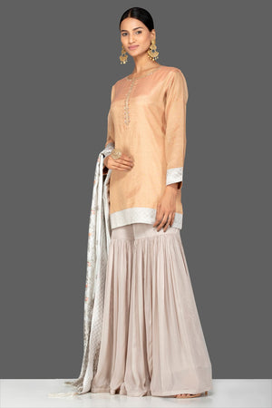 Shop gorgeous golden and grey tissue silk and Banarasi sharara online in USA with matching dupatta. Turn heads at weddings and festive occasions with exquisite Indian women designer clothes from Pure Elegance Indian fashion store in USA. Shop now.-side