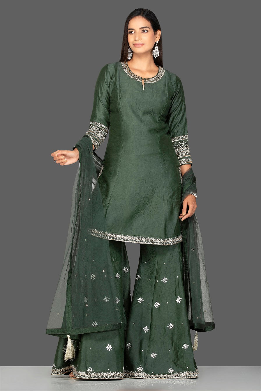 Buy stunning dark green embroidered chanderi silk sharara suit online in USA. Shop exquisite Indian designer clothes for women from Pure Elegance Indian boutique in USA. We have a splendid variety of designer Anarkali suits, traditional salwar suits, sharara suits  for parties and weddings all under one roof.-full view