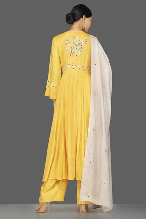 Shop yellow modal silk resham embroidery palazzo suit online in USA. Shop exquisite Indian designer clothes for women from Pure Elegance Indian boutique in USA. We have a splendid variety of designer Anarkali suits, traditional salwar suits, sharara suits  for parties and weddings all under one roof.-back