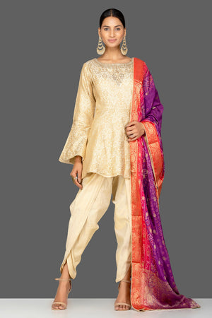 Buy cream embroidered brocade silk salwar suit online in USA with bandhej dupatta. Shop exquisite Indian designer clothes for women from Pure Elegance Indian boutique in USA. We have a splendid variety of designer Anarkali suits, traditional salwar suits, sharara suits  for parties and weddings all under one roof.-front