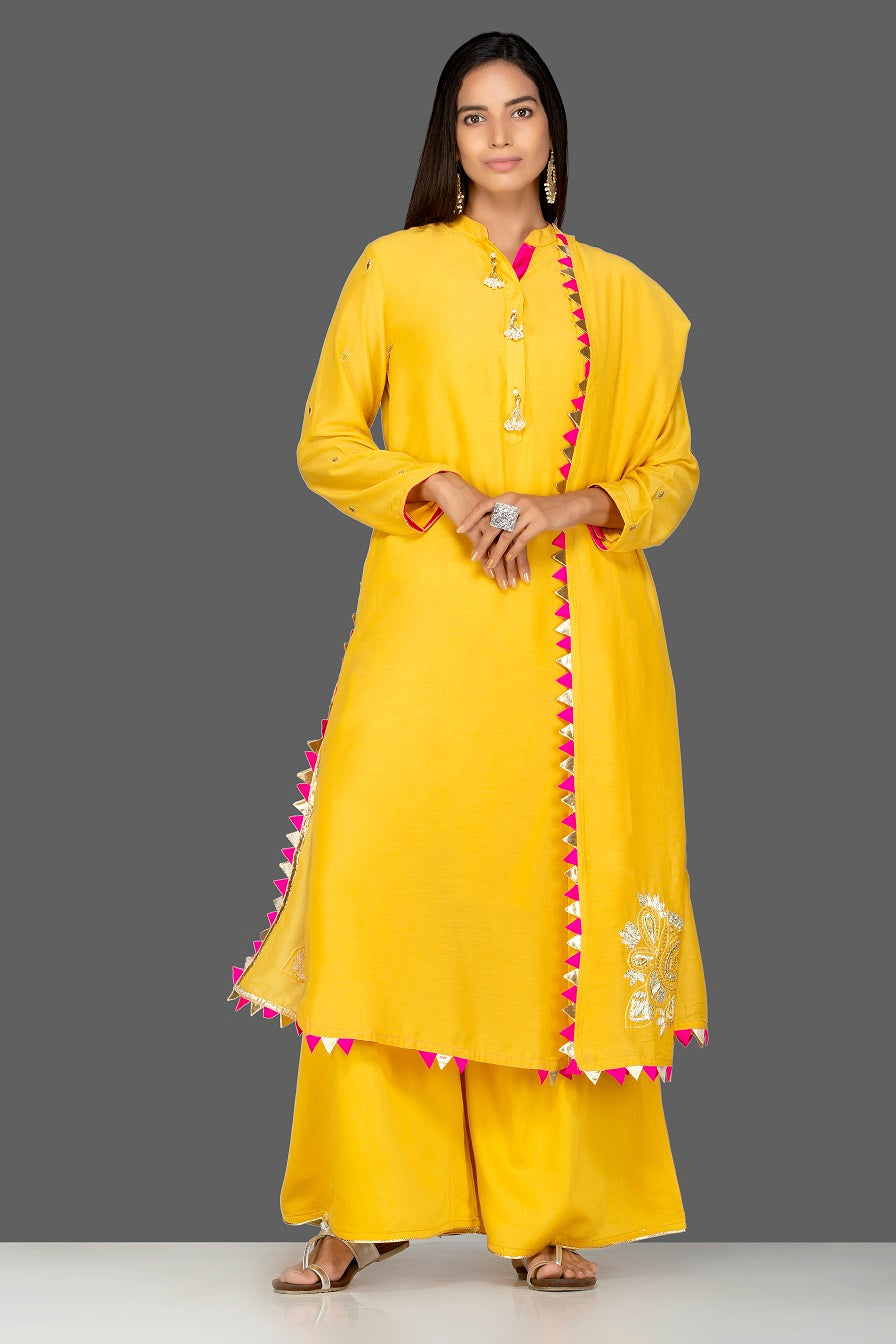 Shop bright yellow embroidered modal silk palazzo suit online in USA with dupatta. Shop exquisite Indian designer clothes for women from Pure Elegance Indian boutique in USA. We have a splendid variety of designer Anarkali suits, traditional salwar suits, sharara suits  for parties and weddings all under one roof.-full view