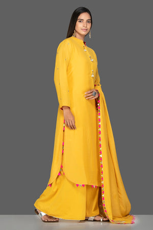Shop bright yellow embroidered modal silk palazzo suit online in USA with dupatta. Shop exquisite Indian designer clothes for women from Pure Elegance Indian boutique in USA. We have a splendid variety of designer Anarkali suits, traditional salwar suits, sharara suits  for parties and weddings all under one roof.-side