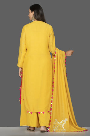 Shop bright yellow embroidered modal silk palazzo suit online in USA with dupatta. Shop exquisite Indian designer clothes for women from Pure Elegance Indian boutique in USA. We have a splendid variety of designer Anarkali suits, traditional salwar suits, sharara suits  for parties and weddings all under one roof.-back