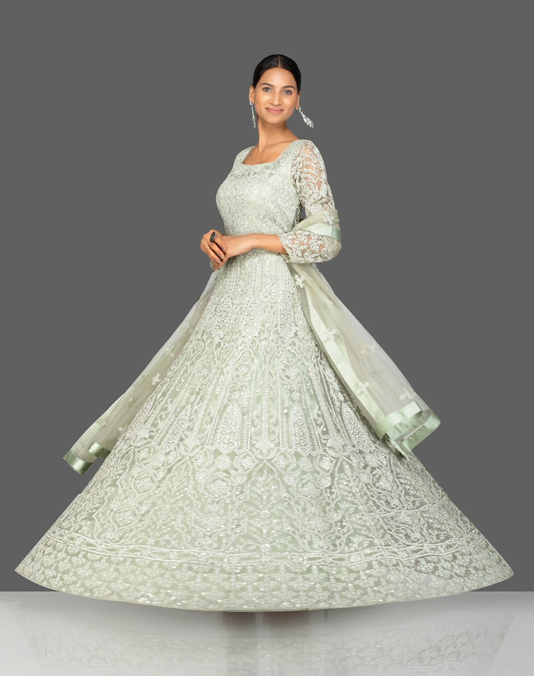Shop grey stone and resham embroidery net Anarkali online in USA with dupatta. Make a stunning fashion statement at weddings and special occasions with an exquisite collection of designer Anarkali suits, traditional salwar suits, bridal lehengas from Pure Elegance Indian fashion store in USA. -side view