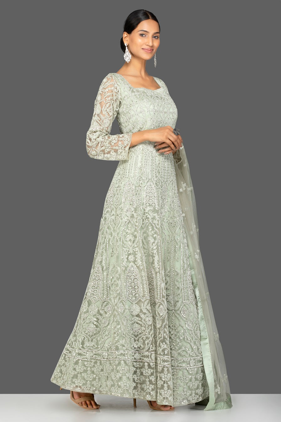 Shop grey stone and resham embroidery net Anarkali online in USA with dupatta. Make a stunning fashion statement at weddings and special occasions with an exquisite collection of designer Anarkali suits, traditional salwar suits, bridal lehengas from Pure Elegance Indian fashion store in USA. -side pose
