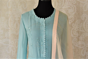 Shop sky blue georgette hand work Anarkali online in USA with cream dupatta. Make your ethnic wardrobe rich and colorful with stunning designer Anarkali suits, palazzo suits, traditional salwar suits from Pure Elegance Indian clothing store in USA.-front