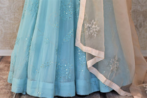 Shop sky blue georgette hand work Anarkali online in USA with cream dupatta. Make your ethnic wardrobe rich and colorful with stunning designer Anarkali suits, palazzo suits, traditional salwar suits from Pure Elegance Indian clothing store in USA.-bottom