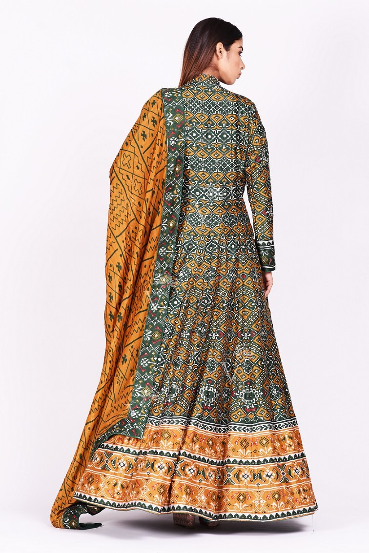 Buy green and mustard printed patola silk Anarkali suit online in USA. Make a stunning fashion statement at weddings and special occasions with an exquisite collection of designer Anarkali suits, traditional salwar suits, designer lehengas from Pure Elegance Indian fashion store in USA. -back