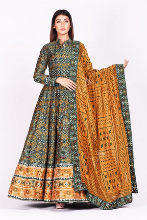 Buy green and mustard printed patola silk Anarkali suit online in USA. Make a stunning fashion statement at weddings and special occasions with an exquisite collection of designer Anarkali suits, traditional salwar suits, designer lehengas from Pure Elegance Indian fashion store in USA. -front