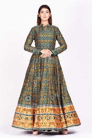 Buy green and mustard printed patola silk Anarkali suit online in USA. Make a stunning fashion statement at weddings and special occasions with an exquisite collection of designer Anarkali suits, traditional salwar suits, designer lehengas from Pure Elegance Indian fashion store in USA. -front view